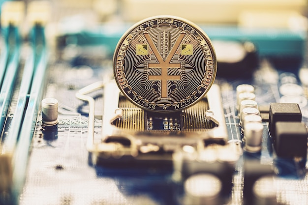 E-rmb gold coin, chinese digital yuan, conceptual image of the digital version of the yuan. chinese decentralized currency, on board and circuits Premium Photo