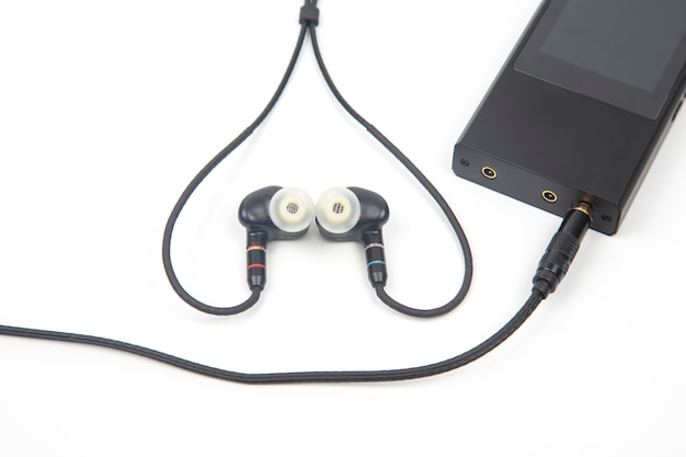 In-ear headphones for hi-fi music player. audio sound and modern equipment for music lovers and audiophiles