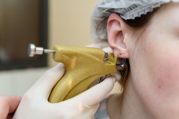 Ear piercing to piercing.