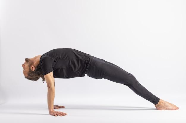 Ear pressure pose wheel pose partner. yoga posture (asana)
