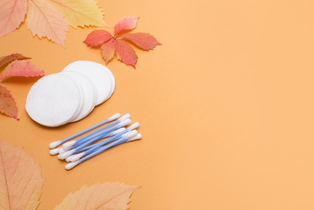 Ear sticks and cotton pads on autumn