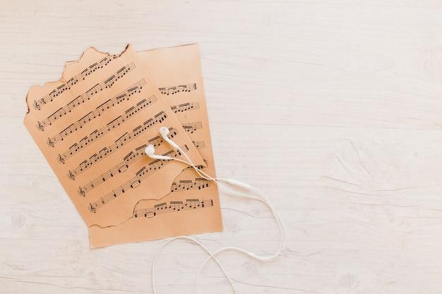 Earphones near sheet music