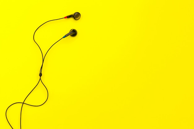 Earphones on yellow