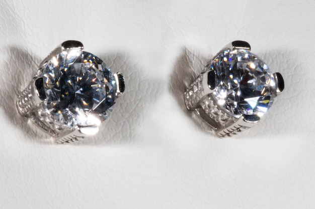 Earrings made of white gold with zircon cheap substitute for a diamond