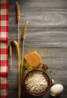 Ears of oat on wooden