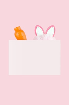 부활절 토끼의 귀와 분홍색 배경에 당근. 부활절 편지 배경입니다. 봄방학