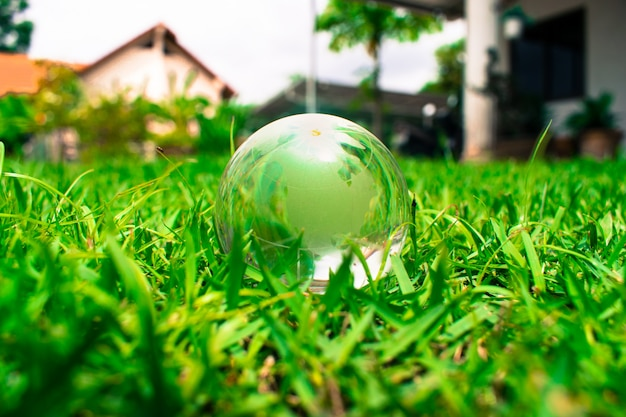 The earth ball is on the yard