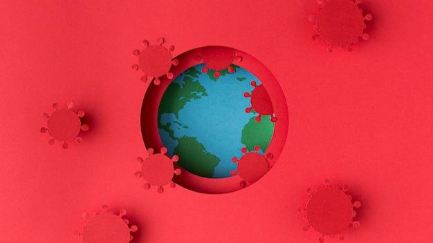 Земной шар из бумаги с коронавирусами