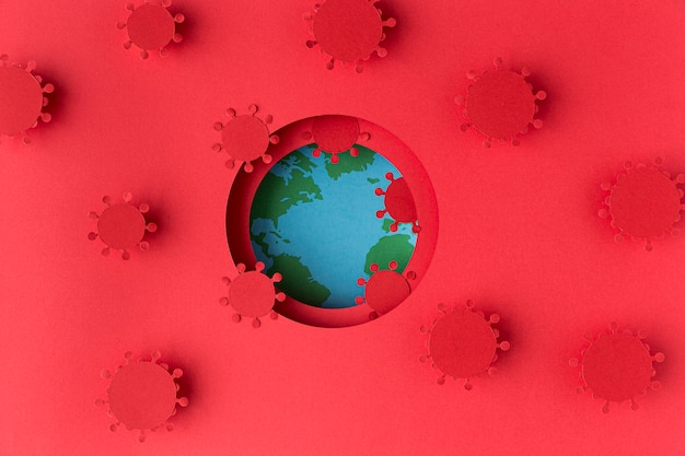 Globo terrestre fatto di carta con coronavirus