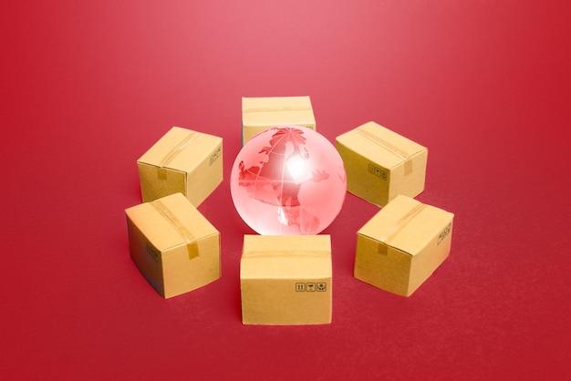 ボックスに囲まれた地球儀。製品・商品のグローバル流通ビジネスシステム