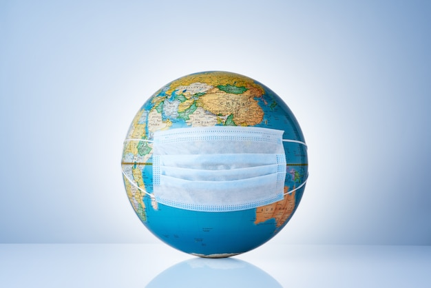 Earth globe with medical mask on