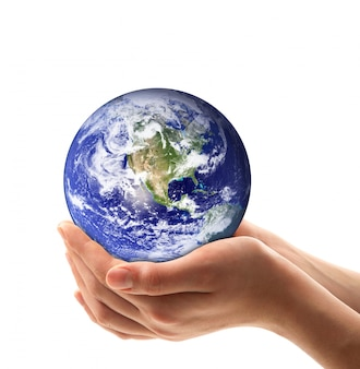 Earth in hands on white background