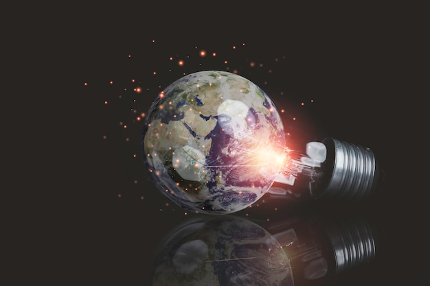 Earth inside of lightbulb for earth day and saving energy environment concept ,element of this image from nasa and 3d render.
