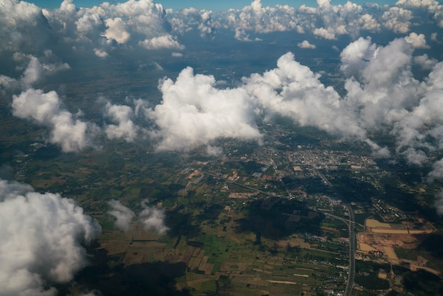 Earth landscape viewed from airplane. earth surface under the white clouds from aerial view.