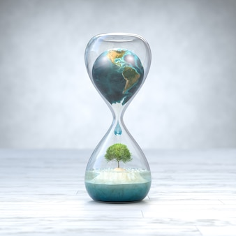 Планета земля в песочных часах, концепция глобального потепления.