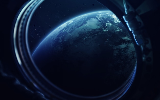 Earth in the porthole of space station.