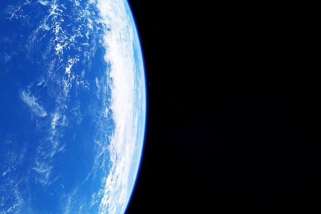 Earth's atmosphere from space, on a dark background. elements of this image were furnished by nasa. high quality photo