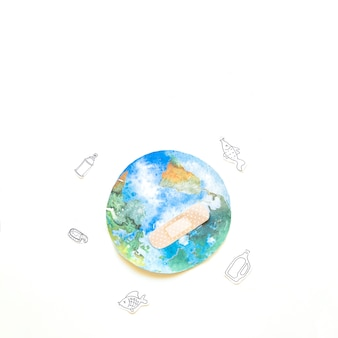 The earth with bandage and litter
