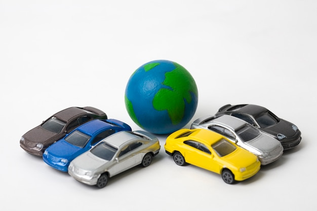 Earth with miniature cars on white