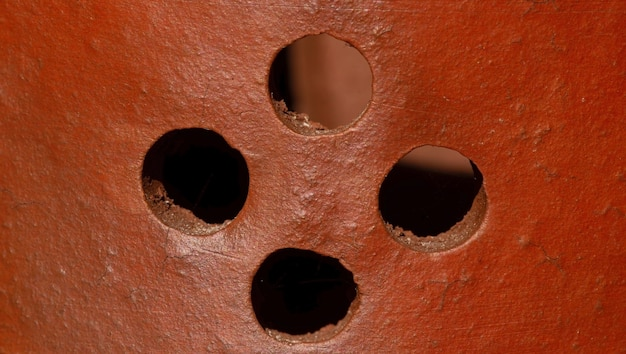 Earthenware handmade clay texture  with holes for background