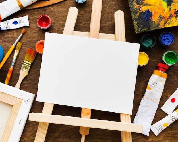Easel and copy space white canvas