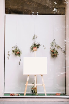 Easel with blank paper sheet