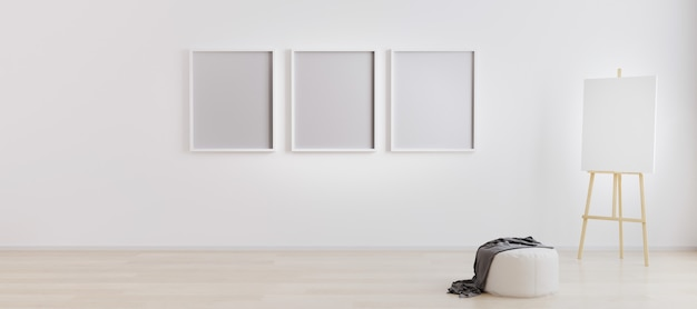 Easel with canvas in bright white room with three blank frames for mockup. artist workspace. empty bright room with three empty frames for mockup. room with white wall and wooden floor. 3d rendering