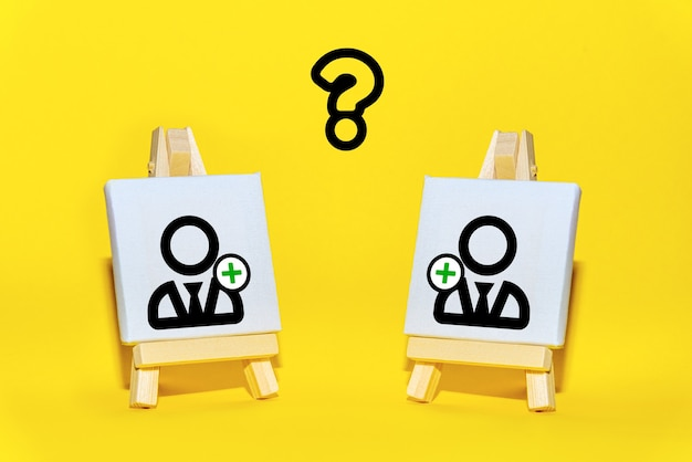 Easels with a new employee symbolize the recruitment of team members. formation and staffing of the project team. searching, hiring new candidates.