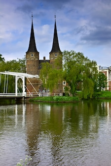East gate with typical bridge, delft, netherlands