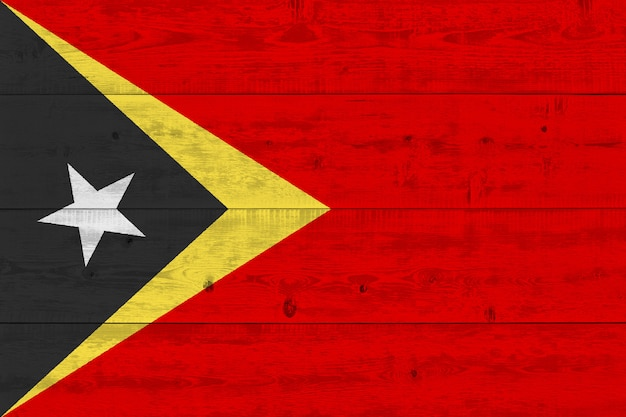 East timor flag painted on old wood plank