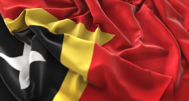 East timor flag ruffled beautifully waving macro close-up shot