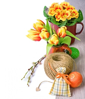 Easter arrangement with tulips, primrose and caption