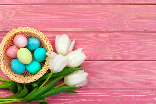 Easter background. colorful eggs in a nest of straw