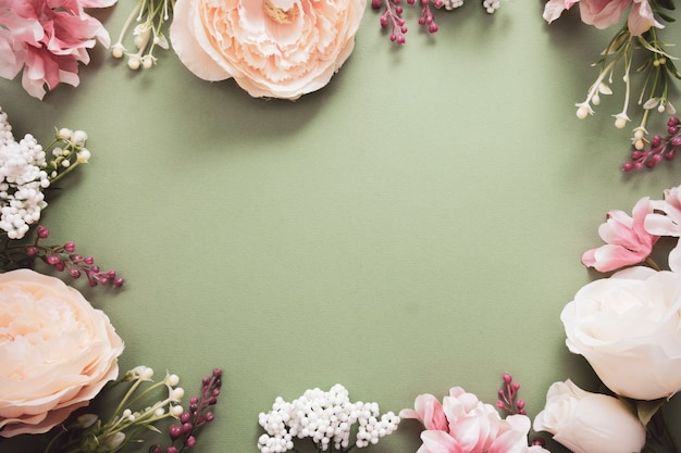 Easter background frame with flower composition on green board. festive frame or border. top view with copy space.