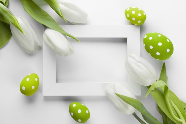 Easter background with colorful eggs over white wood