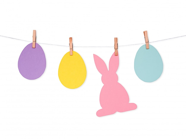 Easter background with colorful paper eggs and rabbit on rope
