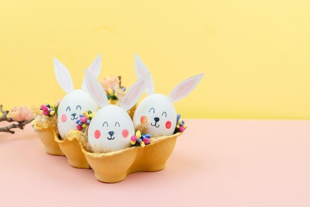 ウサギの形で卵とイースターの背景 Premium写真