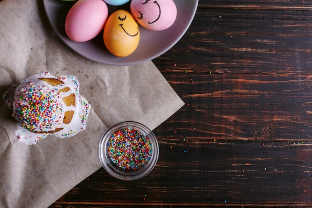 Easter baking with icing and colored powder and eggs