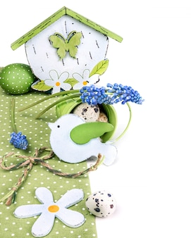 Easter border with blue grape hyacinth and green decorations