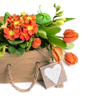 Easter border with orange flowers and spring decorations