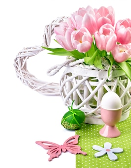 Easter border with pink tulips and matching spring decorations