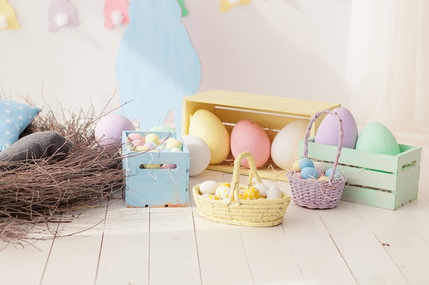 Easter bright composition big painted eggs in wooden boxes