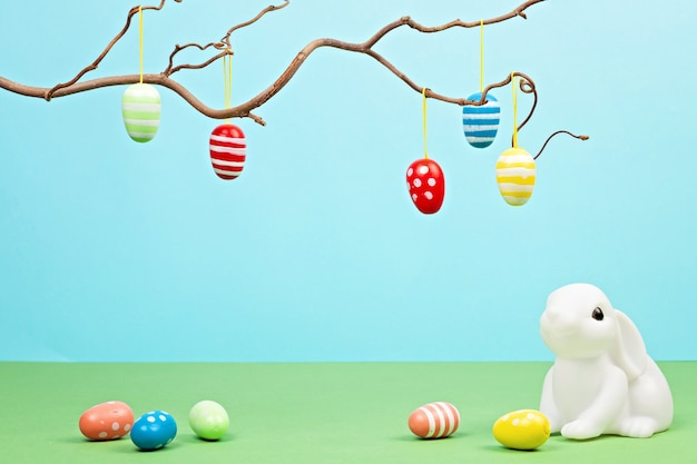 Easter bunnies over pastel background