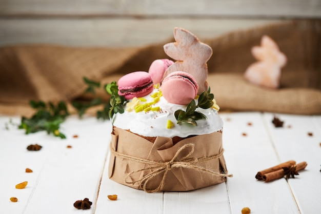 Easter bunny cake on white wooden background, traditional kulich, paska  ready for celebration
