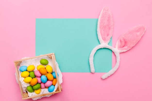 Easter bunny. happy easter holiday background concept.flat lay colorful bunny egg with accessory to celebration on modern rustic pink pastel paper at home office desk.
