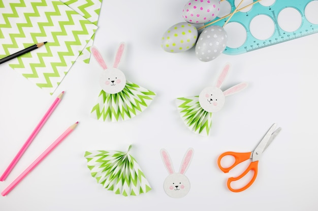 Easter bunny out of paper. diy step by step. crafts concept for kids.