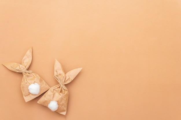 Easter bunny paper gift egg wrapping diy idea on colorful background. minimal easter concept, flat lay, copy space.