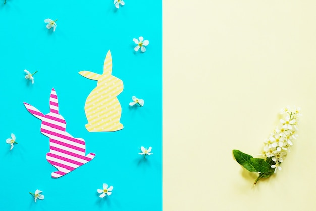Easter bunny paper and spring flowers minimal easter concept top view