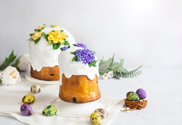 Easter cakes and colorful eggs composition on white background