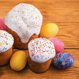 Easter cakes and easter colored eggs on a wooden